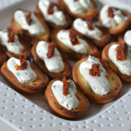Easy Holida Appetizer - Herbed Goat Cheese with Sundried Tomato on Crostini - Supper for a Steal
